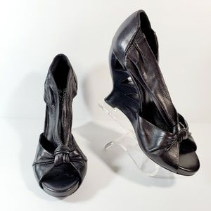 Donald J Pliner black cut out wedge leather heels